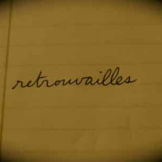 French word retrouvailles written on a notebook