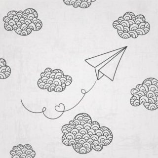 April in Paris - Paper plane flying in the clouds
