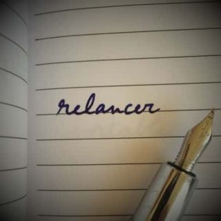 French word relancer on a notebook