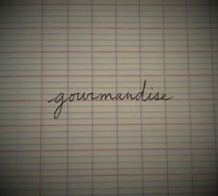 French word gourmandise on a notebook
