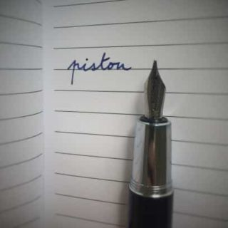French word piston on a notebook