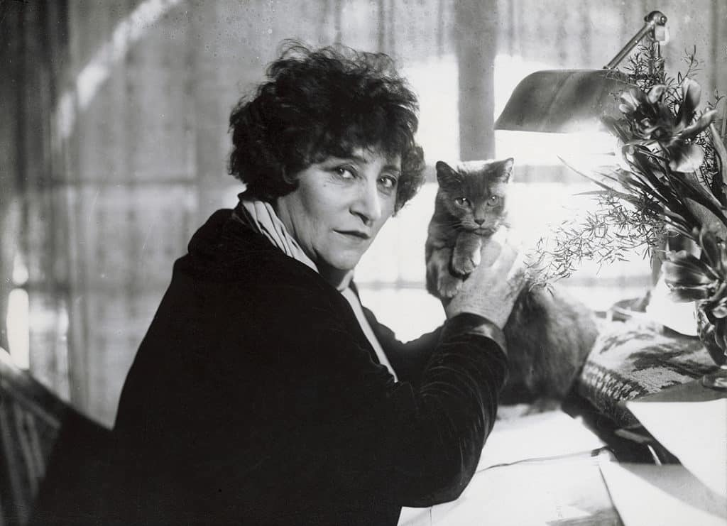 Photo of French author Colette and a cat