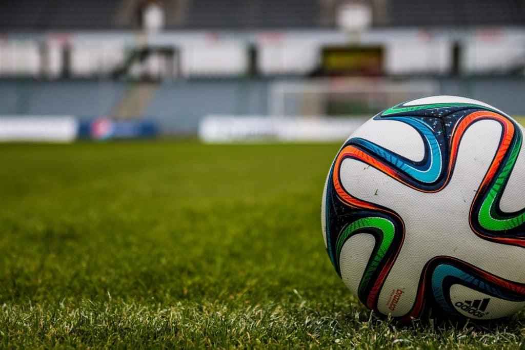 Photo pf a football on a football pitch