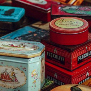tins on sale in a 'marché aux puces'